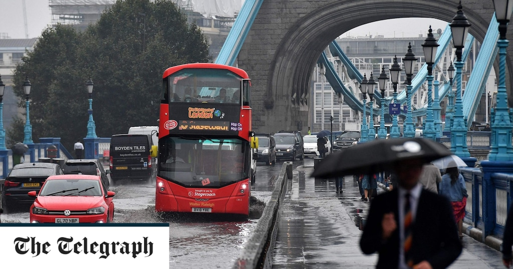 Tower Bridge flooded as month's worth of rain falls on England